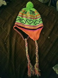 green and orange knit cap