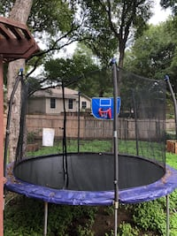 blue and black trampoline with enclosure null