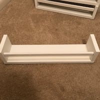 Four white hand painted book shelves