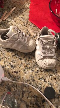 pair of toddler's gray Adidas Superstar sneakers