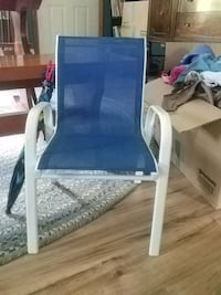 blue and white padded armchair 360 mi