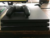 black Sony PS4 console with controller Washington