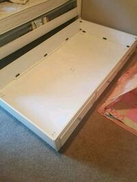 Twin bed storage compartment