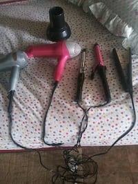 Two hair dryers +two curling iron and a flat iron Houston