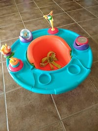 baby's teal and orange activity saucer