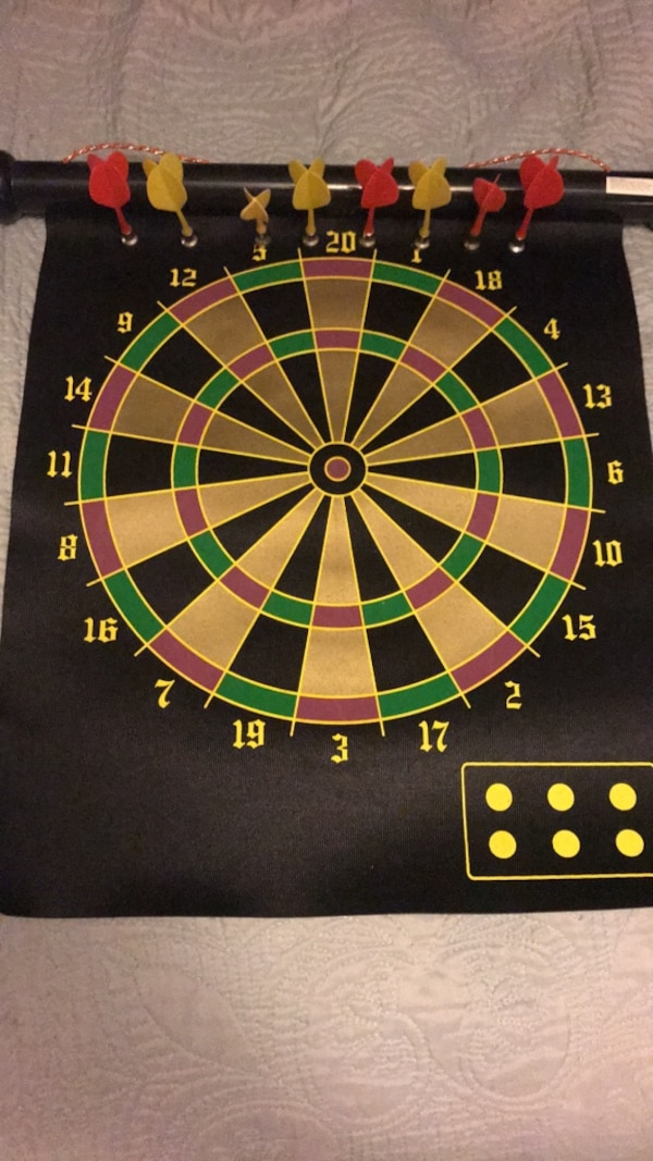 black, green, and red dartboard
