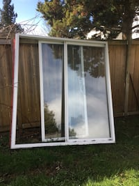 three glass panel with white wooden frames