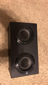 Black and gray poloroid bluetooth speaker