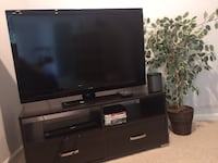 black flat screen TV with black wooden TV stand SILVERSPRING