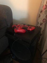 black Sony PS4 console with controller Los Angeles, 90004