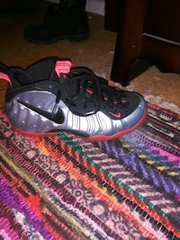 pair of black-and-red Nike Foamposite Capitol Heights, 20743