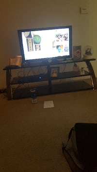 black flat screen TV with black TV stand PHILADELPHIA