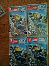 four assorted Nintendo Wii game cases
