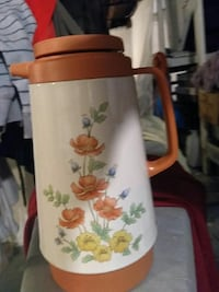 white and orange floral thermal carafe