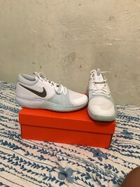 pair of white Nike low-top sneakers West New York, 07093