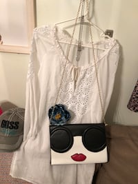 Handbag Retro brand new tags on two left.  Chain included with clutch. Elkhart, 46516