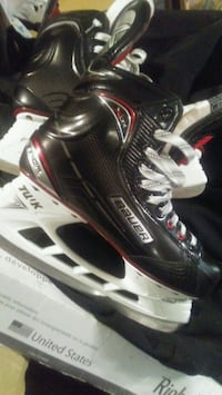 pair of black-and-white Bauer inline skates Surrey, V3V 4T1