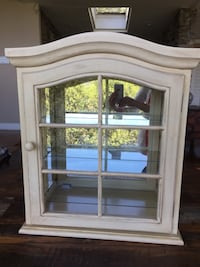 Light yellow farm style mirrored glass cabinet with two removable glass shelves. Pasadena, 91105