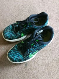 pair of black-and-teal Nike running shoes Guntersville, 35976