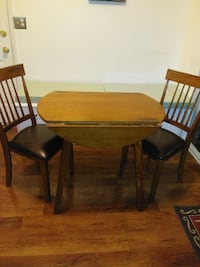 wooden drop leaf table with two chairs dining set