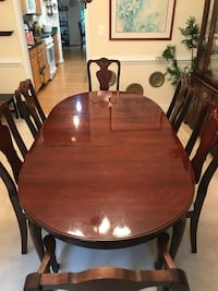 oval brown wooden table with six chairs dining set Manassas, 20111