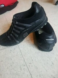 pair of black Sketchers low sneakers Winnipeg, R3B 3C7