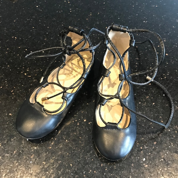 Black ballet flats that lace up the ankles. Size 12 50eceee9-91a0-4fac-a650-c2e81dddf4da