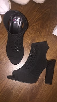pair of women's black open-toe chunky-heeled booties Delta
