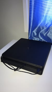 Black sony ps4 slim game console Edmonton, T6W 3M8