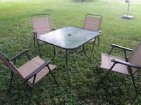 black metal framed glass top patio table with chairs Edinburg, 78542