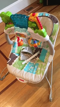 Baby's green and white fisher price bouncer