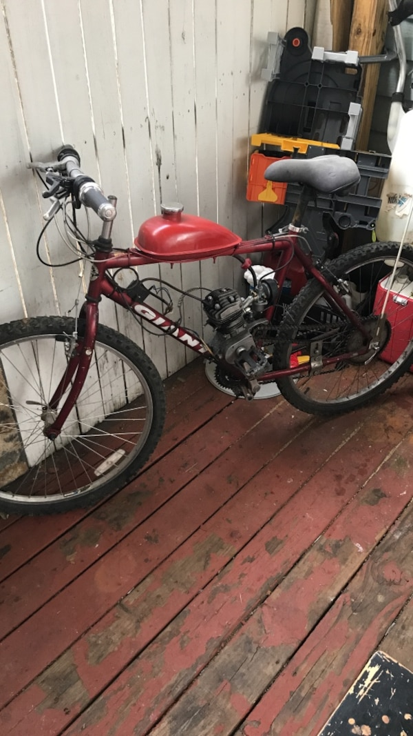 black and red full suspension bike