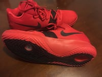Pair of red nike basketball shoes Calgary, T2B 0X7