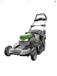 black and green push mower