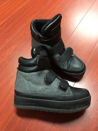 Pair of black high-top sneakers size 6.5