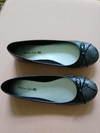 pair of black leather flats ROCHESTER