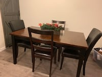 Dark real wood farm style dining table and 4 chairs Santa Clarita, 91350