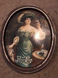 round brown wooden framed painting of woman Sacramento, 95817
