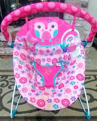 baby's pink and white floral bouncer Turlock, 95382