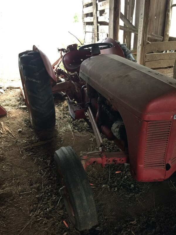 Tractor with implements 499ba425-28b3-4df1-b92a-a9a10bb4041d