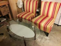 oval clear glass table top with  brown base