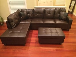 Brown leather sectional couch and ottoman.