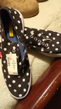 pair of black-and-white polka-dot print lace-up low-top sneakers