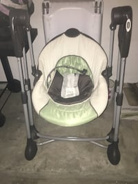 infant swing and infant/toddler car seat with matching stroller Tomball