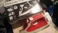 red and white Rowenta clothes iron with box