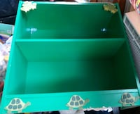 Green frog, turtle, lizard shelf, sturdy, used to store bins on it.