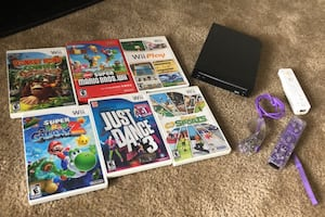 Wii with 6 games and 2 controls