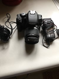 black Canon DSLR camera with lens Donora, 15033