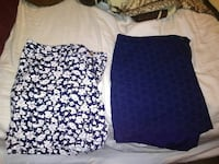 two white and blue floral pencil skirts