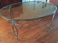 round clear glass top table with gray metal base Memphis, 38119